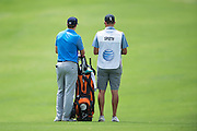 Jordan Spieth and his caddy, Michael Greller, look on during the first round of the AT&T Byron Nelson in Las Colinas, Texas on May 28, 2015. (Cooper Neill for The New York Times)