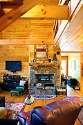 Top selling author Karin Slaughter does all her writing in a cabin in Epworth, Georgia. Her father Howard built the 2,400 square foot cabin for her. A double-sided fireplace in the main living room, seen June 13, 2010..CREDIT: Kendrick Brinson/LUCEO.KarinSlaughter