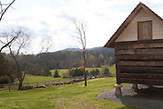 A reproduction of a slave's cabin with a field in the background, Ash Lawn Highland, home of President James Monroe.