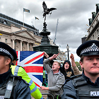 London September 13 : Around 20 members of English Defence League tried to disturb a few hundreds Muslims which  took part in the march of Al Quds Day which  is an annual event opposing Israel's control of Jerusalem,.