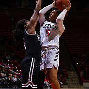 09 November 2018: San Diego State Aztecs guard Te'a Adams (5) takes a contested shot in the second quarter. The Aztecs opened up it's regular season schedule with a 58-57 win over Hawaii Friday at Viejas Arena.