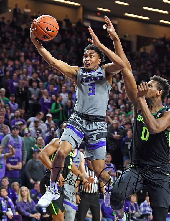 MANHATTAN, KS - MARCH 02:  Kamau Stokes #3 of the Kansas State Wildcats drives to the basket for a lay up during the second half against the Flo Thamba #0 of the Baylor Bears on March 2, 2019 at Bramlage Coliseum in Manhattan, Kansas.  (Photo by Peter G. Aiken/Getty Images) *** Local Caption ***  Kamau Stokes; Flo Thamba