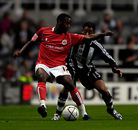 Photo: Jed Wee/Sportsbeat Images.<br /> Newcastle United v Barnsley. Carling Cup. 29/08/2007.<br /> <br /> Barnsley's Rohan Ricketts (L) holds off Newcastle's Nolberto Solano.
