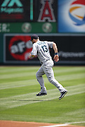 ANAHEIM, CA - JULY 20:  Dustin Ackley #13 of the Seattle Mariners warms up before the game against the Los Angeles Angels of Anaheim at Angel Stadium on Sunday, July 20, 2014 in Anaheim, California. The Angels won the game 6-5. (Photo by Paul Spinelli/MLB Photos via Getty Images) *** Local Caption *** Dustin Ackley