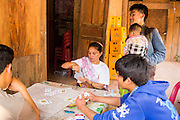 14 MARCH 2013 - BOTEN, LAOS:  People play cards at a truck stop on the Lao/Chinese border in Boten, Laos. PHOTO BY JACK KURTZ