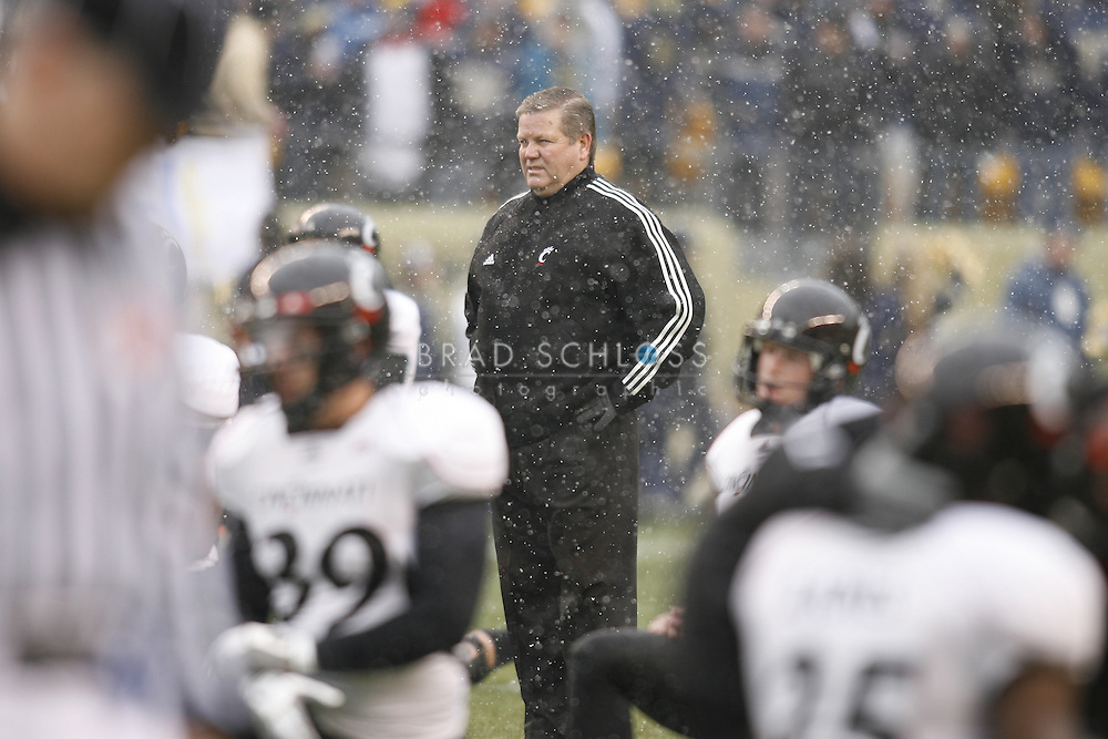 05 DEC 2009: Cincinnati head coach Brian Kelly stands in the cold and snow as his team warms up before the Bearcats thrilling 45-44 come from behind victory today in the Big East Championship at Heinz Field in Pittsburgh, PA.  The win completes a 12-0 undefeated season for Cincinnati and their second consecutive Big East Championship..