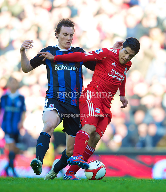 LIVERPOOL, ENGLAND - Sunday March 18, 2012: Liverpool's Luis Alberto Suarez Diaz and Stoke City's Dean Whitehead during the FA Cup Quarter-Final match at Anfield. (Pic by David Rawcliffe/Propaganda)