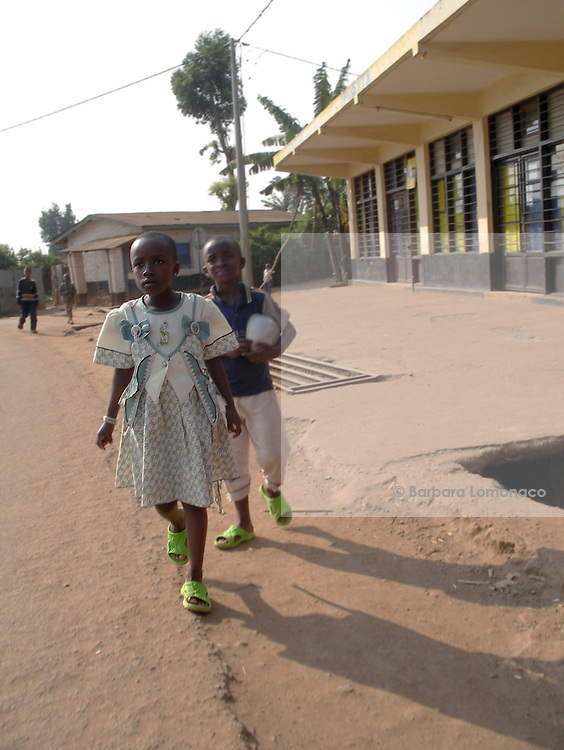 Children walking towards the church in Changugu along the border beteween Rwanda and Congo.