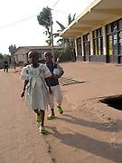 Children walking towards the church in Changugu along the border beteween Rwanda and Congo.