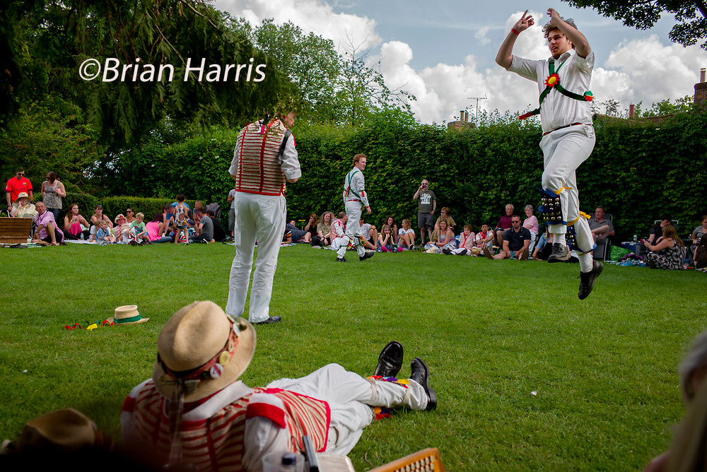 Thaxted Morris Weekend 2-3 June 2018<br /> Thaxted Morris and Country Dancing in Margaret Street Gardens after the main weekend dancing had finished.<br /> Brothers Matt Simons and Ollie Simons-seen here in the air- from the Cambridge Morris Side dance high kicks in the traditional 'Princess Royal from Bampton' music.