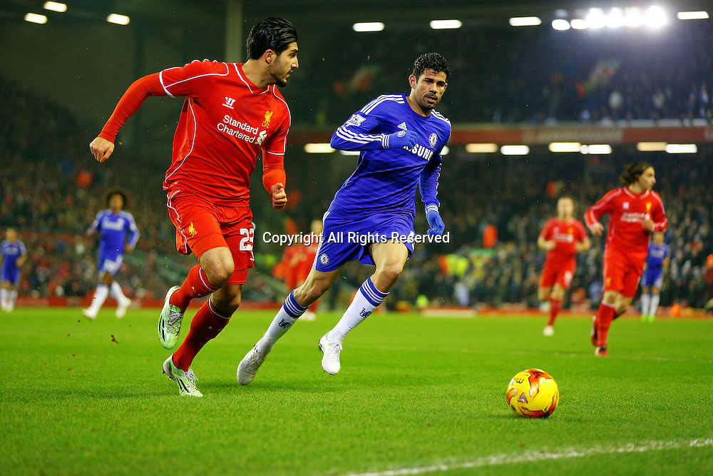 20.01.2015.  Anfield, Liverpool, England. Capital One Cup Semi Final. Liverpool versus Chelsea. Liverpool midfielder Emre Can looks to clear the ball as Chelsea forward Diego Costa closes in