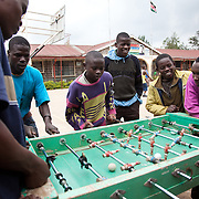 The Stars Foundation visiting Childline Kenya in Nairobi. ..Boys playing table football at the Bosco Boys Children's Home in Karen, Nairobi...The home is one of Childline Kenya's referral partners in protecting children.