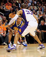 Feb. 10, 2011; Phoenix, AZ, USA; Golden State Warriors guard Monta Ellis (8) handles the ball against the Phoenix Suns forward Grant Hill (33) at the US Airways Center. Mandatory Credit: Jennifer Stewart-US PRESSWIRE