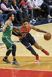 April 10, 2018 - Washington, DC, U.S. - WASHINGTON, DC - APRIL 10:  Washington Wizards forward Kelly Oubre Jr. (12) drives to the basket and is fouled by Boston Celtics guard Shane Larkin (8) on April 10, 2018 at the Capital One Arena in Washington, D.C.  The Washington Wizards defeated the Boston Celtics, 113-101.  (Photo by Icon Sportswire) (Credit Image: © Icon Sportswire/Icon SMI via ZUMA Press)