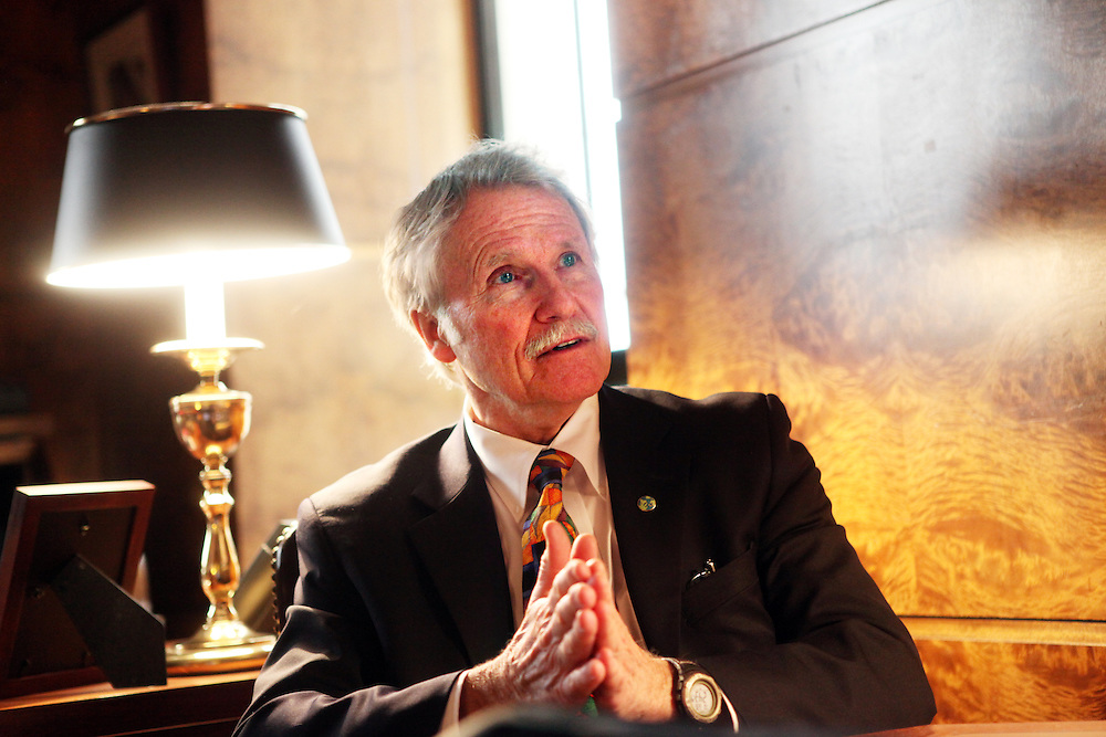 Oregon Gov. John Kitzhaber, a former emergency room doctor, is guiding the state on a different course regarding health care by helping to reduce the number of uninsured Oregonians.