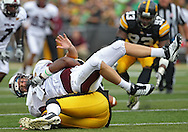 September 24, 2011: Louisiana Monroe Warhawks quarterback Cody Wells (14) is hit by Iowa Hawkeyes defensive lineman Lebron Daniel (58) during the third quarter of the game between the Iowa Hawkeyes and the Louisiana Monroe Warhawks at Kinnick Stadium in Iowa City, Iowa on Saturday, September 24, 2011. Iowa defeated Louisiana Monroe 45-17.