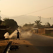 A woman walks to her morning chores in the Chibitoke neighbourhood of Bujumbura. Cibitoke have in the past couple of moths been the scene of violent protests against the presidents third term bid.