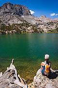 Hiker on the shore of Big Pine Lake #5, John Muir Wilderness, Sierra Nevada Mountains, California USA