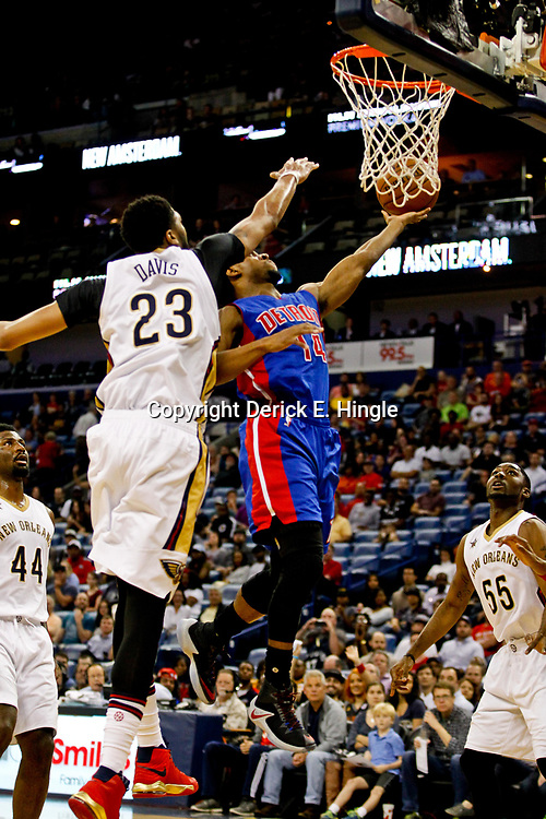 Mar 1, 2017; New Orleans, LA, USA; Detroit Pistons guard Ish Smith (14) shoots over New Orleans Pelicans forward Anthony Davis (23) during the first quarter of a game at the Smoothie King Center. Mandatory Credit: Derick E. Hingle-USA TODAY Sports