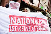 Frankfurt am Main | 26 Apr 2014<br /> <br /> Am Samstag (26.04.2014) veranstalten Aktivisten der rechtspopulistischen AfD (Alternative f&uuml;r Deutschland) auf der Leipziger Stra&szlig;e in Frankfurt-Bockenheim einen Infostand, sie versuchen, Infomaterial und Flugbl&auml;tter an Passanten zu verteilen, um f&uuml;r die Partei im laufenden Europawahlkampf zu werben.<br /> Die AfD-Wahlk&auml;mpfer werden durchgehend von etwa 50 linksradikalen Aktivisten gest&ouml;rt und behindert.<br /> hier: Linke Gegendemonstranten mit einem Transparent mit der Aufschrift &quot;Nationalismus ist keine Alternative&quot;. <br /> <br /> &copy;peter-juelich.com<br /> <br /> [No Model Release | No Property Release]