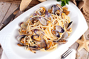 Plate of spaghetti with clams, typical recipe of the Mediterranean cuisine.