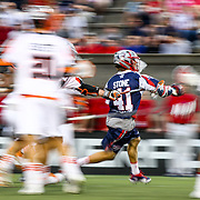 Mike Stone #41 of the Boston Cannons runs with the ball though traffic during the game at Harvard Stadium on May 10, 2014 in Boston, Massachusetts. (Photo by Elan Kawesch)