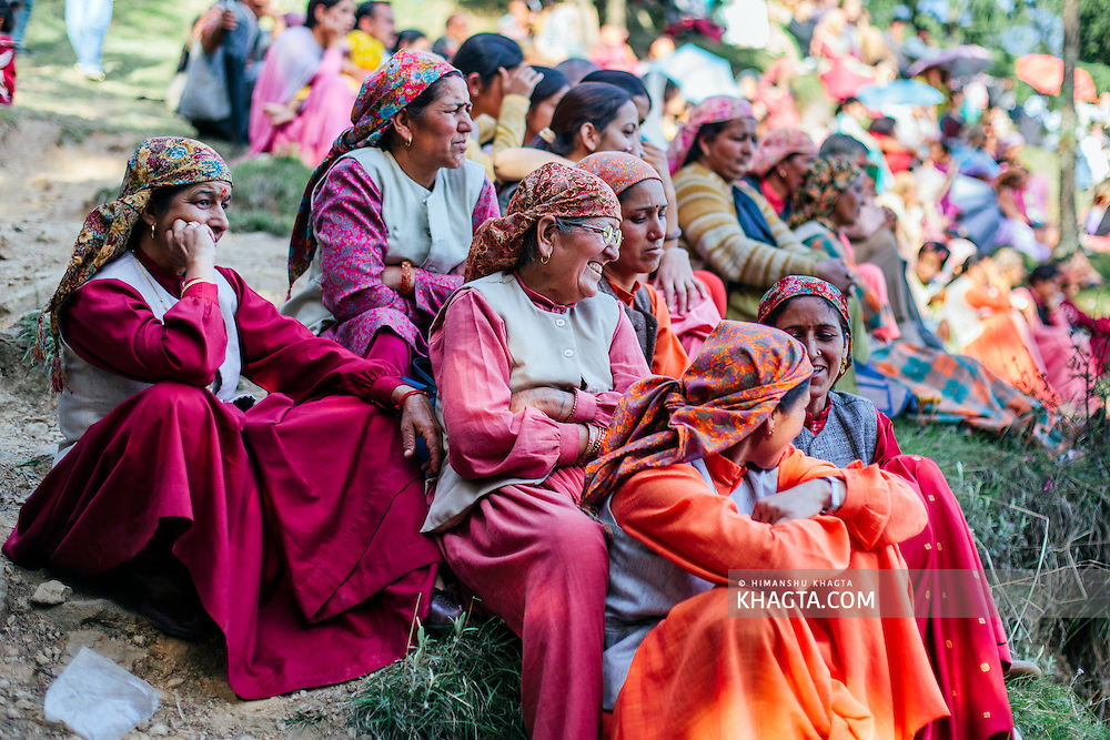 Ladies from Kotgarh, dressed up in colorful traditional clothes sitting at Tani Jubbar to attend the Annual Tani Jubbar Mela