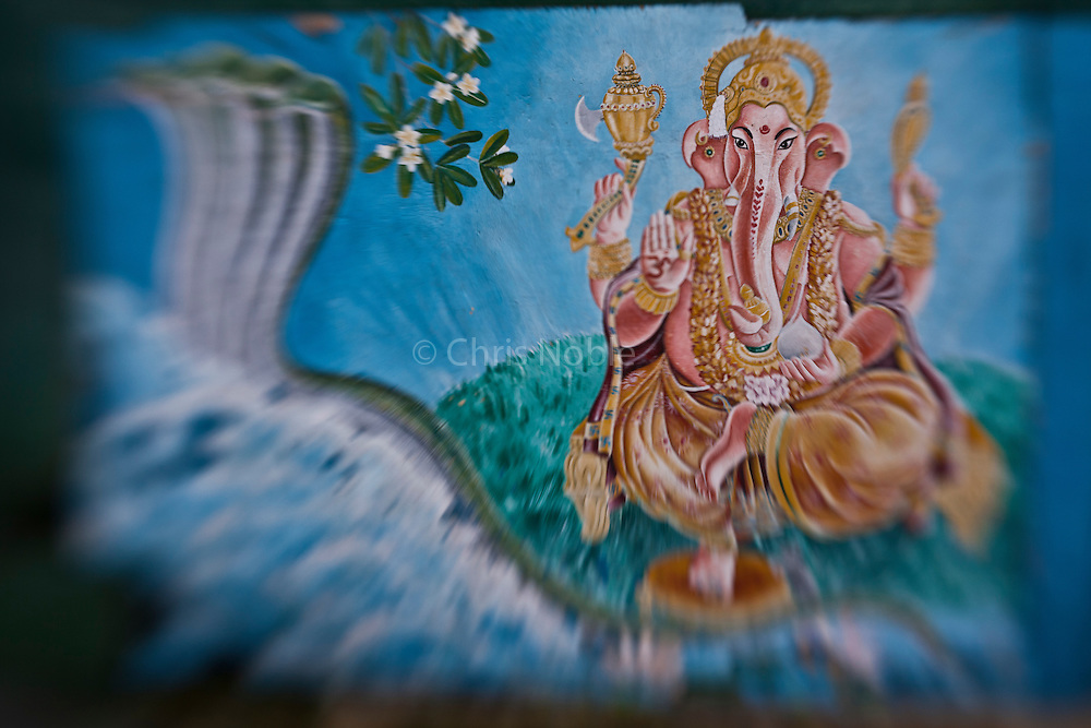 A painting of the Hindu elephant-headed god Ganesha  adorns the walls of a temple at Kathmandu's Pashupatinath.