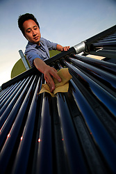 CHINA HONG KONG 24MAY10 - Sustainability officer Calvin Lee Kwan maintains a pilot solar thermal water heating installation at Hong Kong's Science and Technology University...jre/Photo by Jiri Rezac..© Jiri Rezac 2010