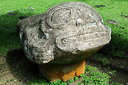 Tiki Makii Tau'a Pepe, carved in grey keetu or volcanic tuff, representing a woman lying on her stomach with outstretched arms and raised head with huge eyes and mouth, thought to be in the process of childbirth, at the Iipona archaeological site, near the village of Puamau, on the island of Hiva Oa, in the Marquesas Islands, French Polynesia. On the base of this sculpture are petroglyph reliefs of dogs, whose meaning is unclear. Tiki sculptures are usually carved in wood or stone and represent Ti'i, a half-human half-god ancestor who is believed to be the first man. Tiki often have a huge head, symbolising power, and big eyes symbolising knowledge. Tiki are respected and are often placed outside houses as protective statues. The Iipona site was a religious sanctuary or meae, built by the pre-European Marquesian civilisation, arranged over 2 large terraces with 5 monumental tikis. Picture by Manuel Cohen