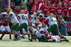 16 October 2010:  Jose Mohler bumps into D.J. McNorton while being sacked by Eric Brunner during a game where the North Dakota State Bison lost to the Illinois State Redbirds 34-24, meeting at Hancock Stadium on the campus of Illinois State University in Normal Illinois.