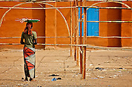 Woman watching the beginning of the set up of a market in Segou, Mali, 2009<br /> &copy;Ingetje Tadros