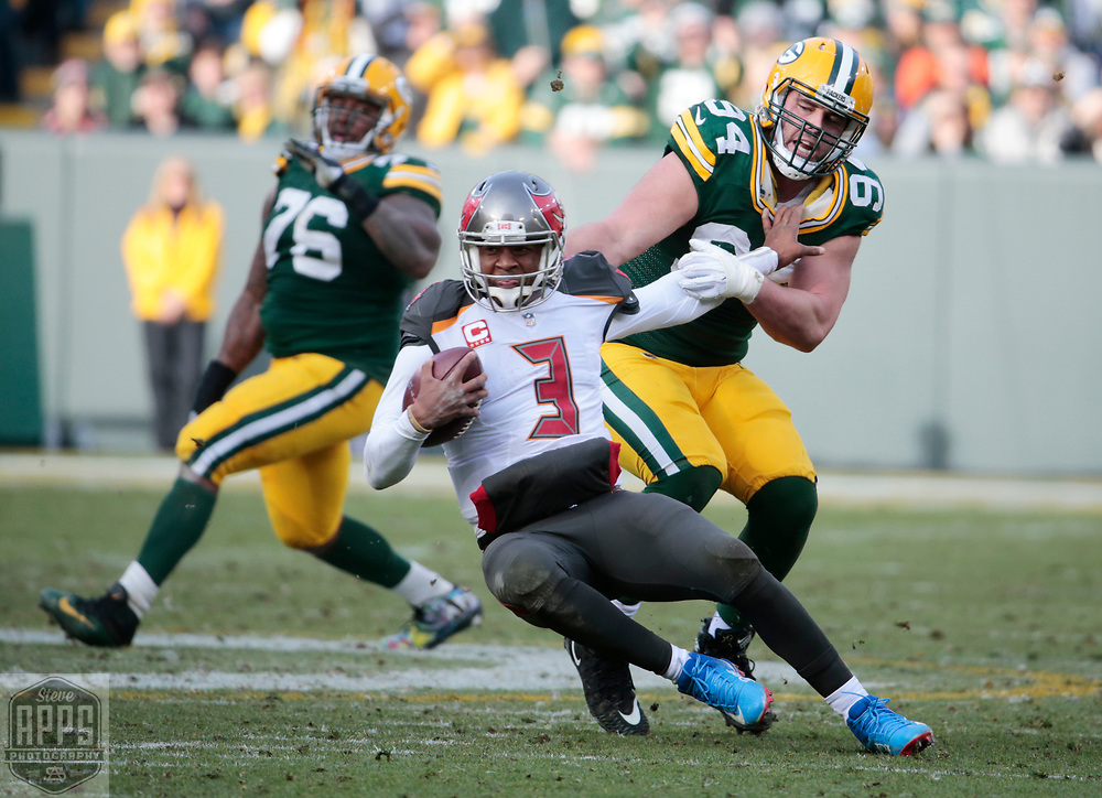 Green Bay Packers defensive end Dean Lowry (94) sacked Tampa Bay Buccaneers quarterback Jameis Winston (3) for a 14-yard loss in the 3rd quarter. <br /> The Green Bay Packers hosted the Tampa Bay Buccaneers at Lambeau Field in Green Bay,  Sunday, Dec. 3, 2017. The Packers won in 26-20 in Overtime.   STEVE APPS FOR THE STATE JOURNAL.