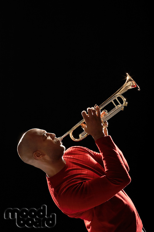 Man Playing Trumpet side view