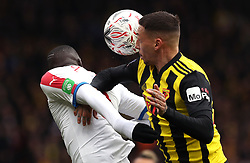 Crystal Palace's Cheikhou Kouyate (left) and Watford's Jose Holebas battle for the ball during the FA Cup quarter final match at Vicarage Road, Watford.