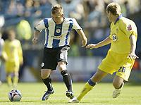 Photo: Aidan Ellis.<br /> Sheffield Wednesday v Leeds United. Coca Cola Championship. 27/08/2006.<br /> Wednesday's Glenn Whelan (L) takes on Leeds Matthew Killgallon