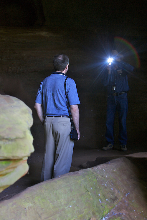 Ohio University Professor Dr. Alexander V. Sergeev, left, has his picture taken in the Rock House in the Hocking Hills by Durward Metts of Barnesville, Ohio on Friday, October 5, 2007..Photo by Kevin Riddell