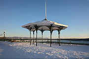 Gazebo in the snow on the Dufferin Terrace, built in 1879 under the direction of Lord Dufferin, Governor-General of Canada, overlooking the Saint Lawrence river, in Quebec City, Quebec, Canada. The Historic District of Old Quebec is listed as a UNESCO World Heritage Site. Picture by Manuel Cohen