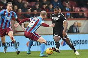 Neil Bishop of Scunthorpe United and Donervon Daniels of Wigan Athletic fight for the ball  during the Sky Bet League 1 match between Scunthorpe United and Wigan Athletic at Glanford Park, Scunthorpe, England on 2 January 2016. Photo by Ian Lyall.
