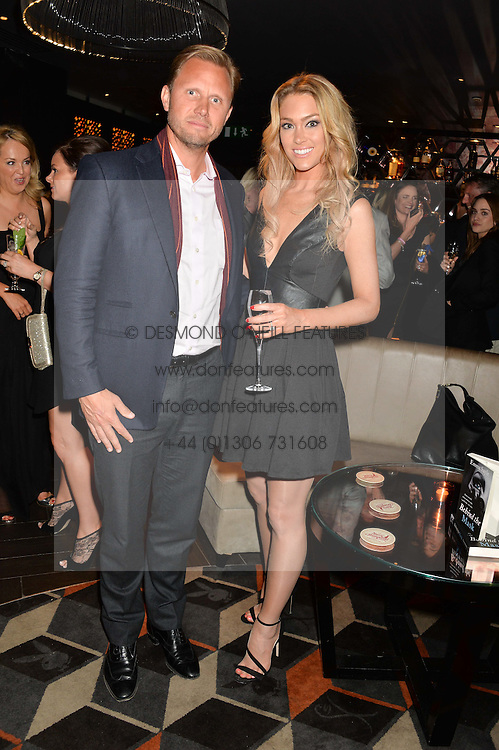 CHRISTIAN LAGERLING and CASSANDRA HARRIS at a party to celebrate the publication of Behind The Mask by Emma Sayle held at The Playboy Club, 14 Old Park Lane, London on 23rd April 2014.