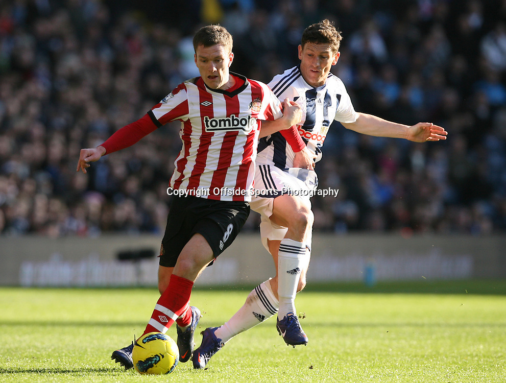 25/02/2012 - Barclays Premier League - West Bromwich Albion vs. Sunderland - Keith Andrews of West Brom battles with Craig Gardner of Sunderland - Photo: Simon Stacpoole / Offside.