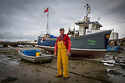 Shaun (Skippy) Skippon<br /> <br /> Opportunity FE6<br /> <br /> 1st Generation Fisherman<br /> <br /> Main Activity: Netting<br /> Folkestone was founded on its fishing industry which dates back to pre-Roman times.  During its heyday there were over 100 boats operating out of the busy harbour and employing over 1000 people in the town.  However today, there are only 8 working boats left, employing just over 20 people. The boats are owned and managed by Folkestone families who have a strong fishing heritage. Photographer Andrew Aitchison, has been working with Folkestone Trawlers to capture portraits of the active fishermen in the summer of 2016.
