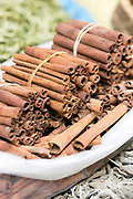 FEZ, MOROCCO - 5th MARCH 2016 - Tied bundles of cinnamon sticks for sale in the souks of the old Fez Medina, Middle Atlas Mountains, Morocco.