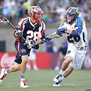 Brent Adams #28 of the Boston Cannons looks to get past John Haus #26 of the Charlotte Hounds during the game at Harvard Stadium on May 17, 2014 in Boston, Massachuttes. (Photo by Elan Kawesch)