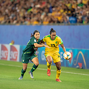 GRENOBLE, FRANCE June 18.  Sam Kerr #20 of Australia challenges Allyson Swaby #17 of Jamaica during the Jamaica V Australia, Group C match at the FIFA Women's World Cup at Stade des Alpes on June 18th 2019 in Grenoble, France. (Photo by Tim Clayton/Corbis via Getty Images)