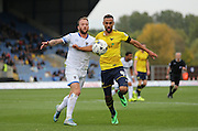 AFC Wimbledon midfielder Sean Rigg (11) and Oxford United midfielder Kemar Roofe (4) compete during the Sky Bet League 2 match between Oxford United and AFC Wimbledon at the Kassam Stadium, Oxford, England on 10 October 2015.