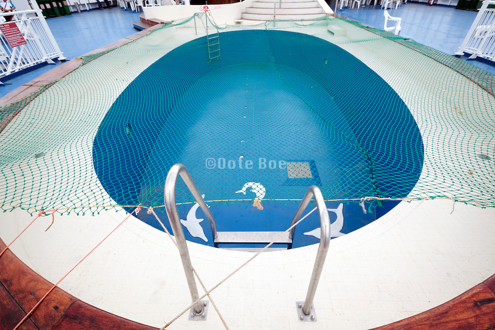 empty swimming pool on cruise ship covered with a net