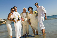 Two newly wed couples and a best man at ocean (portrait)