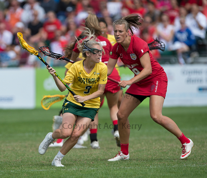 Australia's  Sarah Mollison gets away from England's  laura Merrifield at the Rathbones Women's Lacrosse World Cup, at Surrey Sports Park, Guildford, Surrey, UK, 16th July 2017.