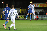 AFC Wimbledon midfielder Anthony Wordsworth (40) battles for possession with Rochdale defender Jordan Williams (8) during the EFL Sky Bet League 1 match between AFC Wimbledon and Rochdale at the Cherry Red Records Stadium, Kingston, England on 8 December 2018.